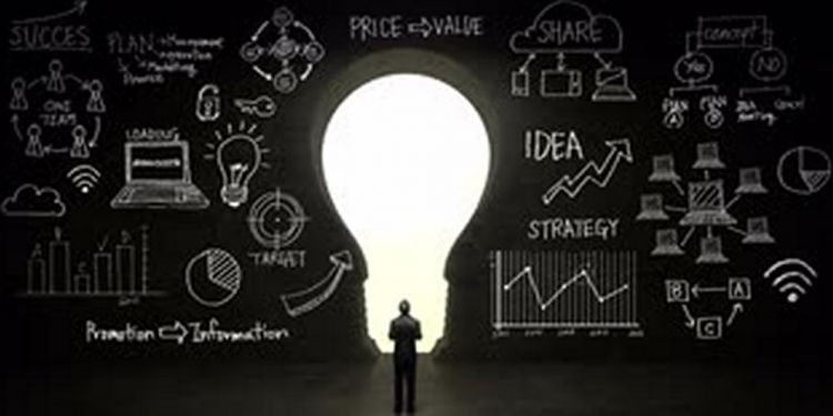 businessman standing in front of black shape of bulb light business plan and various graph in black wall concept nzanncdog S0014 1024x768 min eea2c